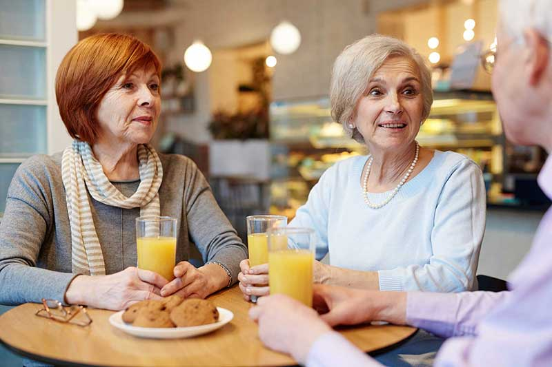 Group of seniors at a cafe