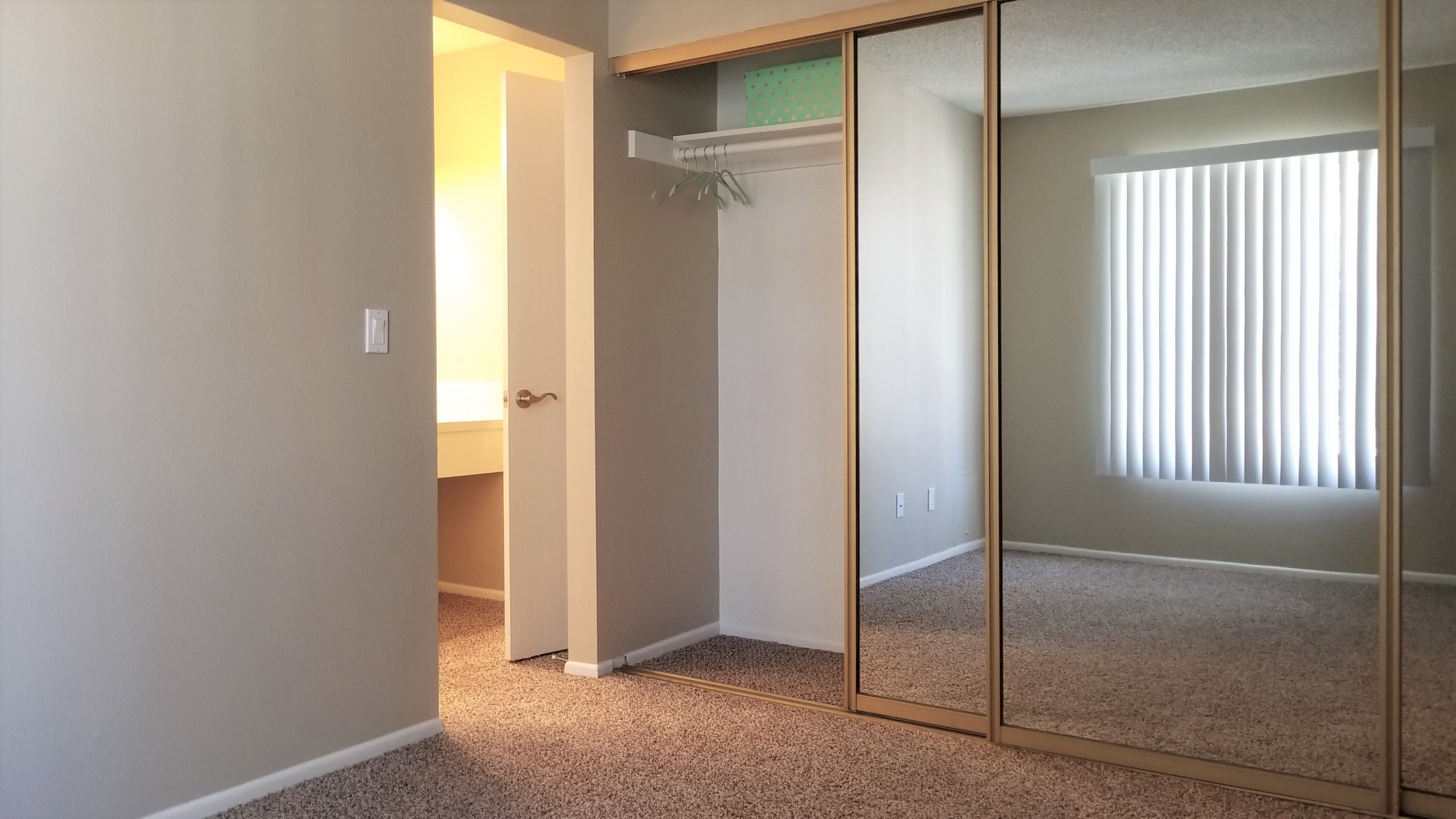Spacious bedroom with sliding closet doors